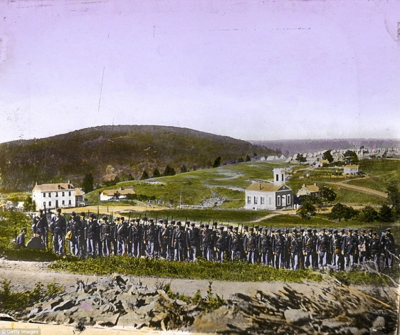 2545C00500000578-2936871-Union_troops_at_parade_rest_in_1863_The_war_was_fought_between_t-a-46_1422978017270