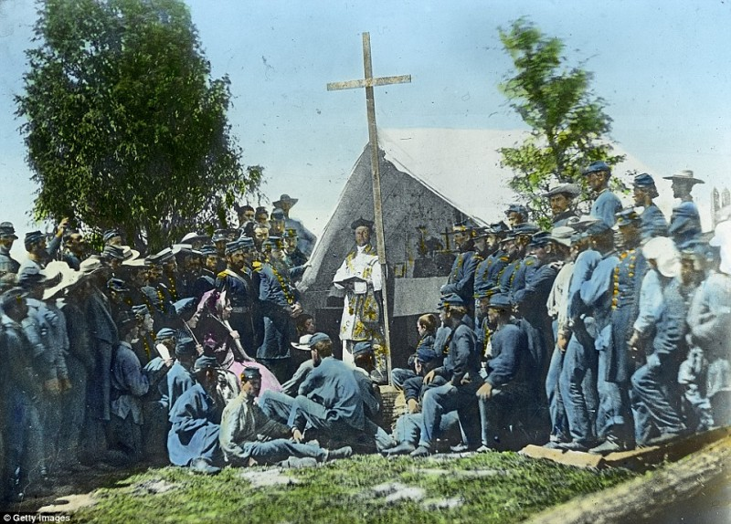 2545C05D00000578-2936871-Father_Mooney_performs_mass_with_the_69th_infantry_the_regiment_-a-55_1422978017502