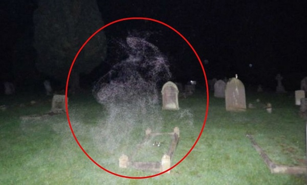 ghost-cemetary-praying-woman-uk